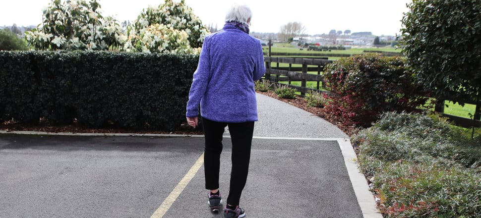 Older person walking alone.